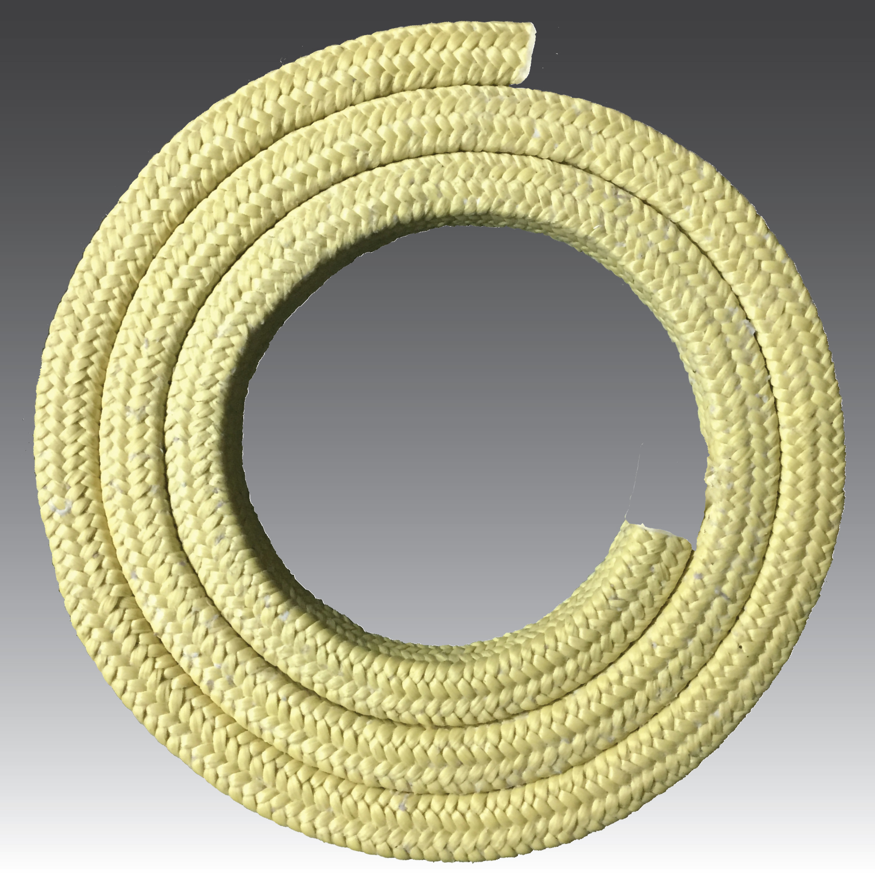Aramid fibers treated with lubricants and PTFE